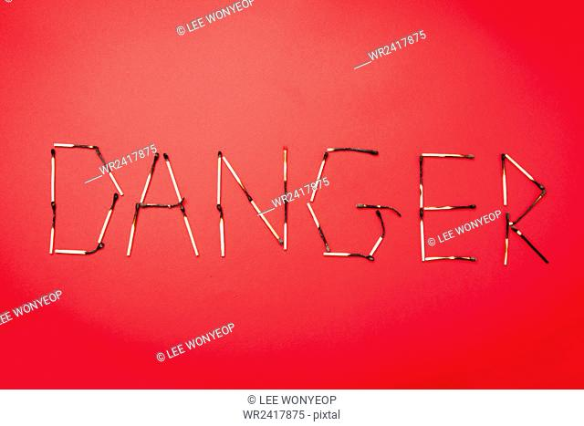 Matches in DANGER sign on red background