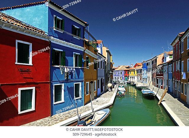 General street view of multicoloured houses in Burano, Giudecca Di Burano, Veneto, Italy