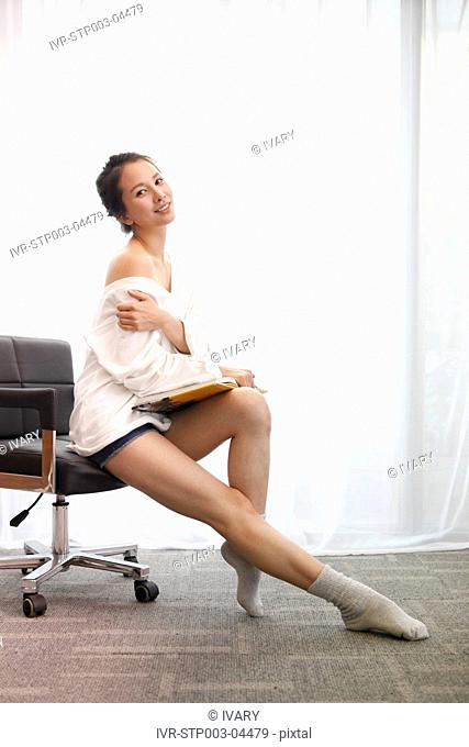 A young woman sitting in a chair