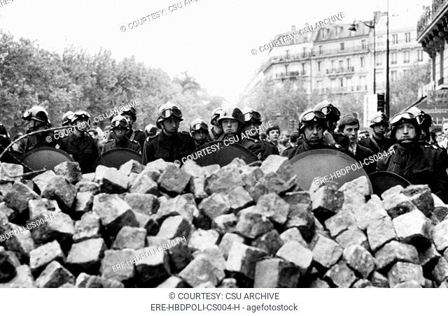 Police behind a barricade made of stones by rioting students in the Latin Quarter of Paris, France, 1960s