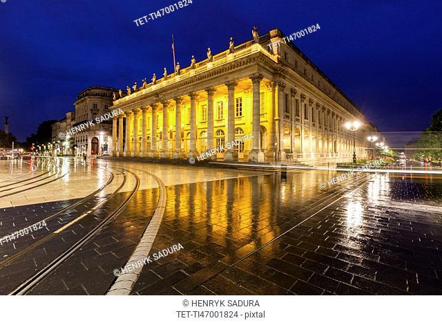 France, Nouvelle-Aquitaine, Bordeaux, Grand Theatre de Bordeaux at night in rain