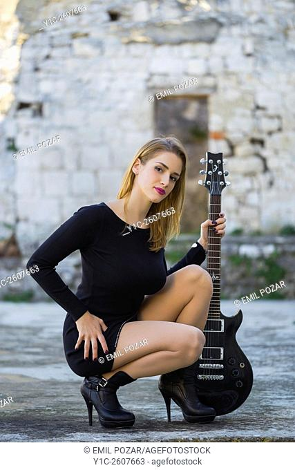 Attractive young woman and guitar
