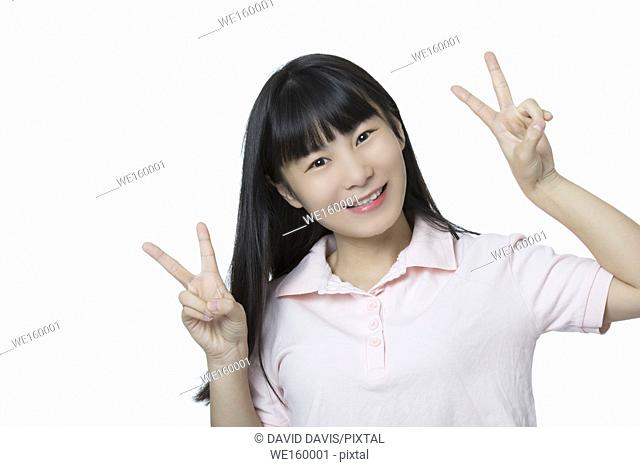 Portrait of a Beautiful Chinese American woman displaying a bit of attitude isolated on a white background