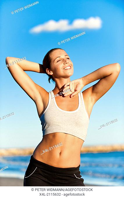 young, pretty, sportive woman on the beach (model-released)