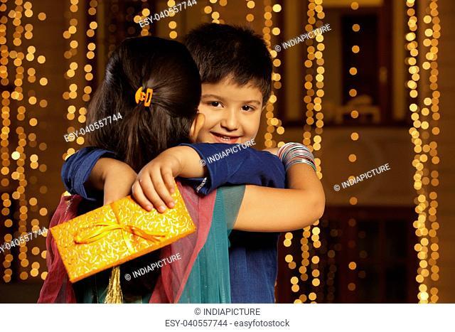 Portrait of boy hugging girl