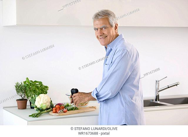 Mature man preparing food
