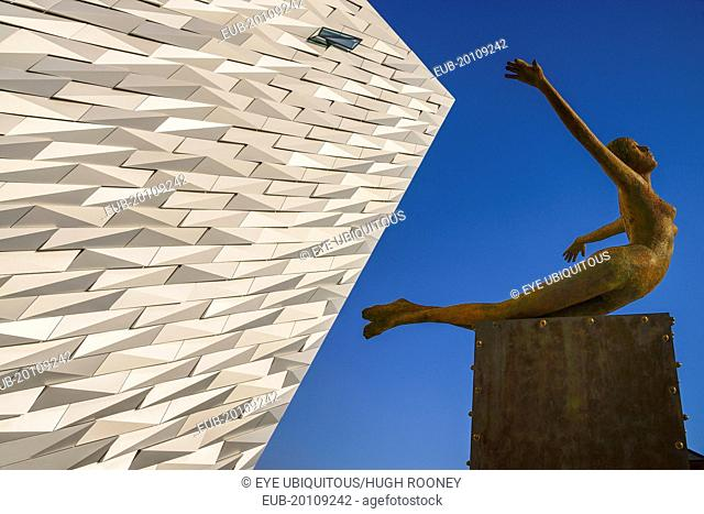 Titanic Quarter, Titanic Belfast Visitor Experience, 'Titanica' sculpture by Rowan Gillespie with a section of the building and blue sky in the background