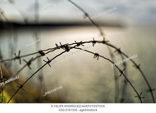 Barbed wire, Pointe du Hoc, Normandy. Pointe du Hoc is a promontory with a 100 ft (30 m) cliff overlooking the English Channel on the coast of Normandy in...