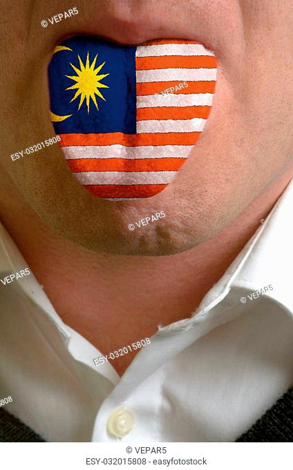 man wit open mouth spreading tongue colored in malaysia flag as symbol of values like teaching, learning, multilingual speaking of different languages