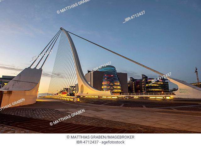 Samuel Beckett Bridge, cable-stayed bridge and swing bridge over the river Liffey, blue hour, architect Santiago Calatrava, Dublin, Republic of Ireland