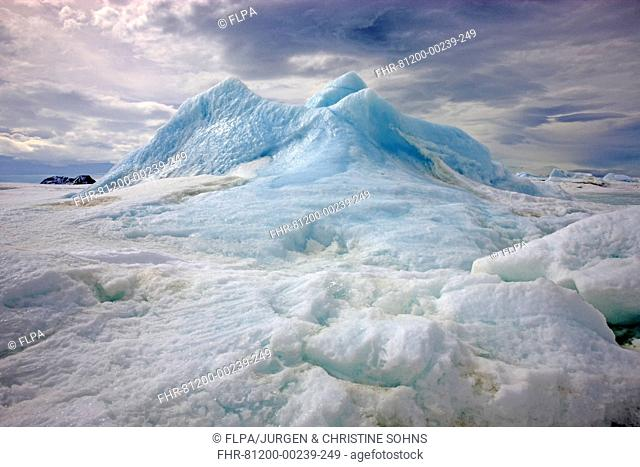 Pack ice and trapped blue iceberg, Devil Island, Weddell Sea, Antarctica, November