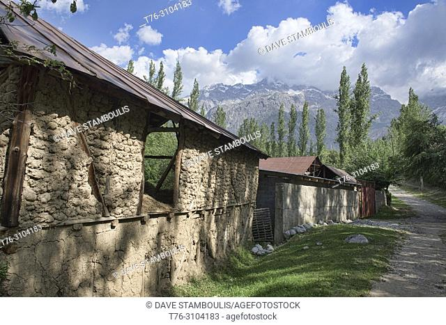 Traditional farm and high peaks above the walnut village of Arslanbob, Kygyzstan