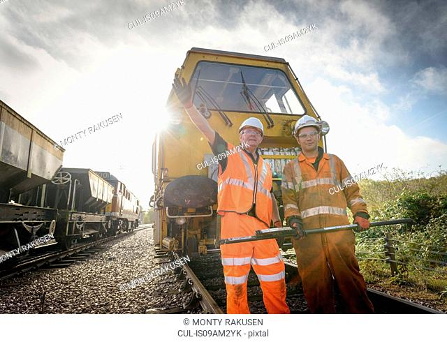 Maintenance workers signalling to train on railway