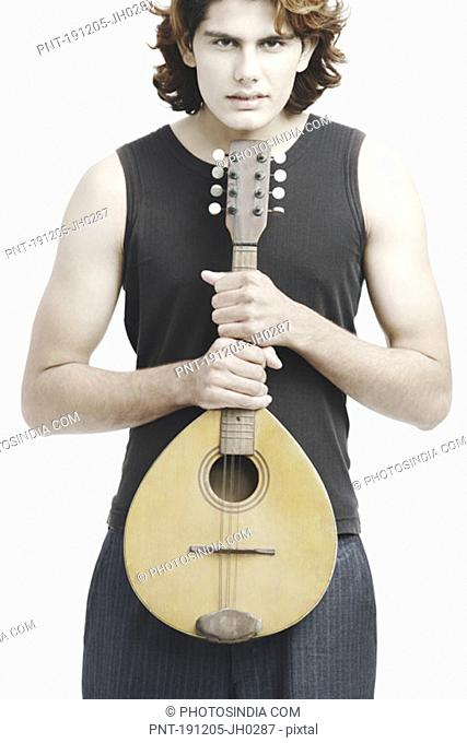 Portrait of a male musician playing the banjo