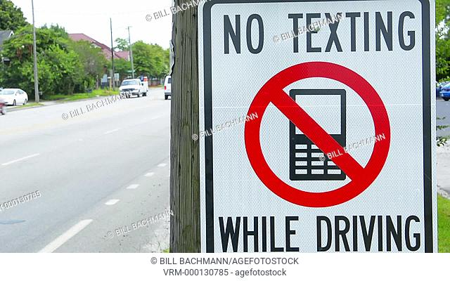 NO TEXTING WHILE DRIVING sign dangerous practice