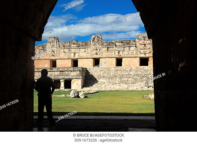 A man in the gate of the Nunnery Quadrangle Cuadrangulo de las Monjas in the ancient Mayan city of Uxmal  Uxmal  Mexico