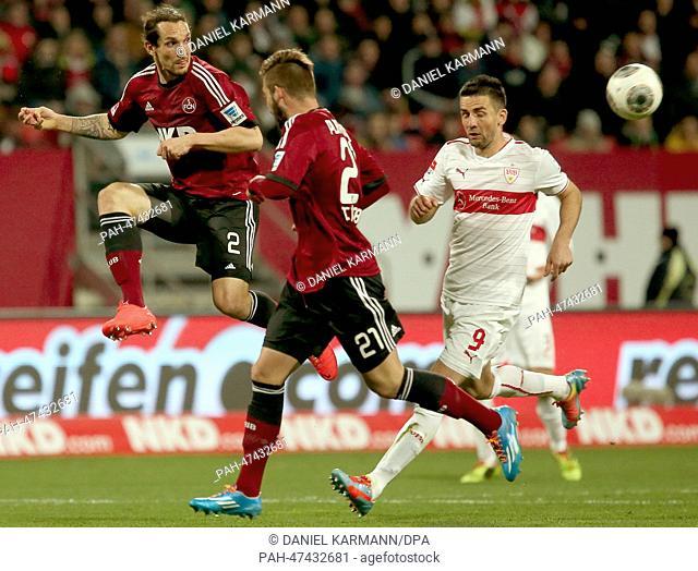 Nuremberg's Emanuel Pogatetz (L) vies for the ball with Stuttgart's Marvin Plattenhardt (C) during the German Bundesliga match between FCNuremberg and VfB...