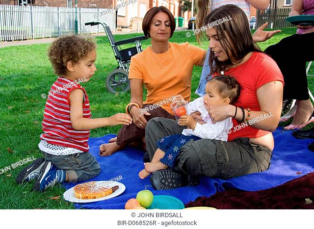 Family enjoying a picnic in the park