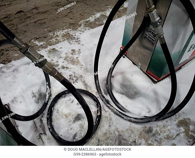 Gas tank hoses at a convenience store during a cold snap, Windsor, Ontario, Canada