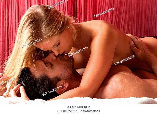 Loving young nude erotic sensual couple in bed