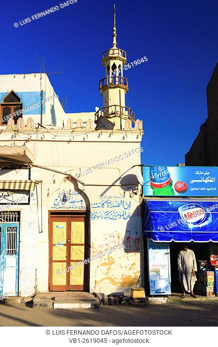 Street scene with shop, man and little mosque in downtown Luxor, Egypt