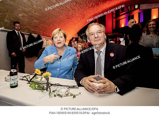 05.09.2018, Berlin: Federal Chancellor Angela Merkel of the Christian Democratic Union (CDU, l), and Reiner Haseloff of the Christian Democratic Union (CDU)