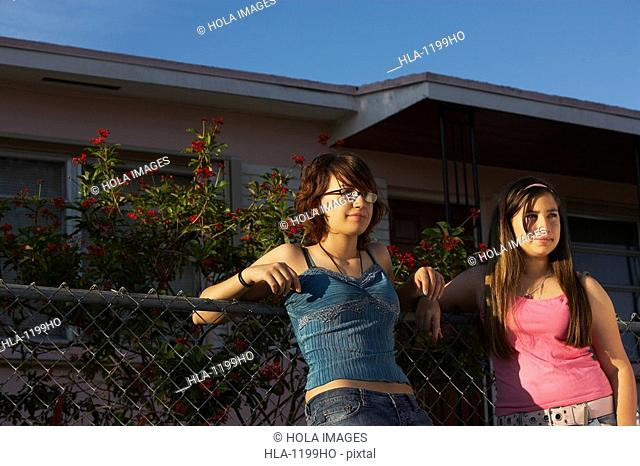 Teenage girl standing with her sister