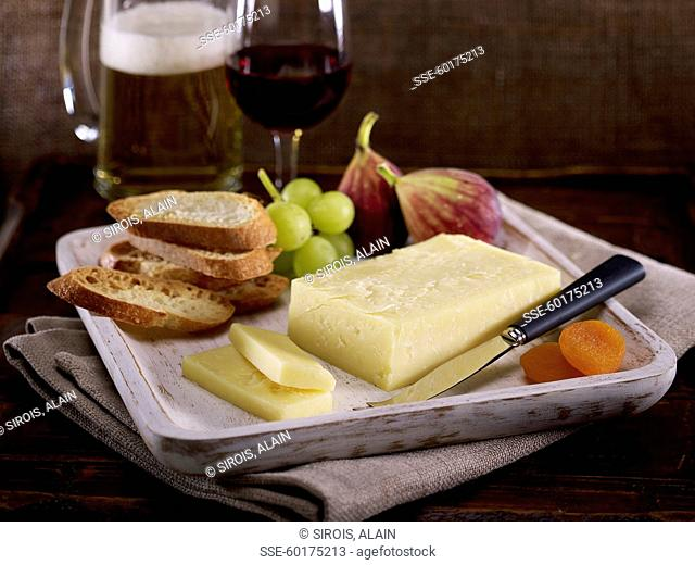Plate of cheese with fruit and bread
