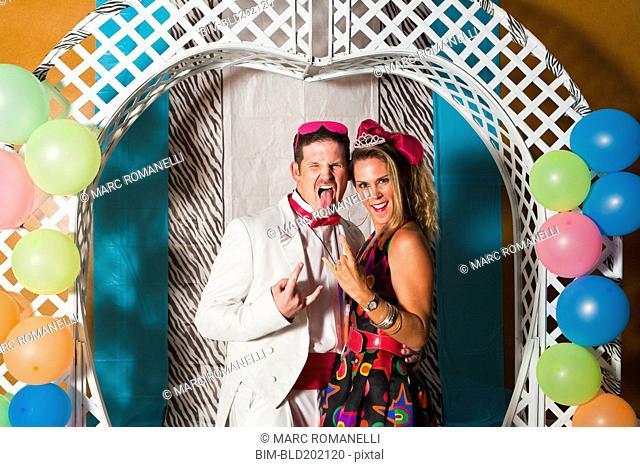 Caucasian couple at retro prom