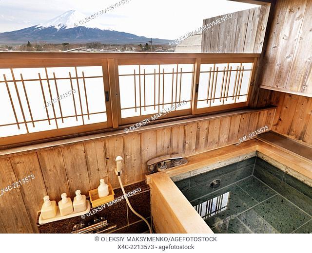 Onsen, hot spring bath tab at ryokan with Mount Fuji view. Fujikawaguchiko, Yamanashi, Japan