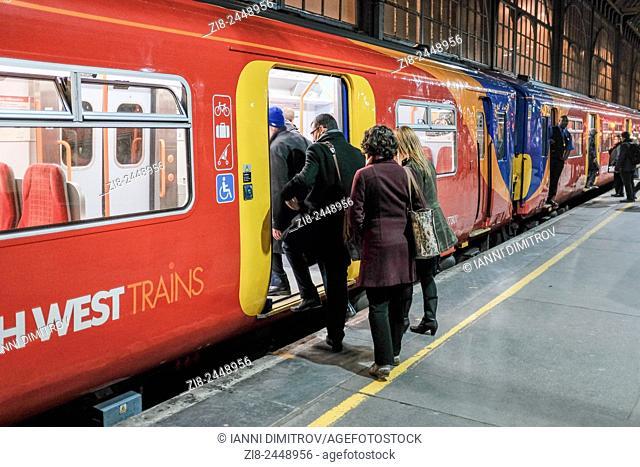 Commuters boarding suburban train ,Waterloo Station,London,England