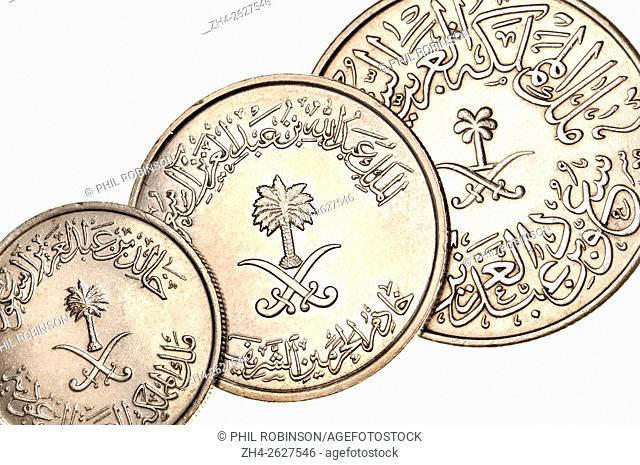 Coins of Saudi Arabia showing Arabic writing and symbols (cupro-nickel) 10 Halala, 50 Halala and 4 Ghirsh showing palm tree and crossed swords