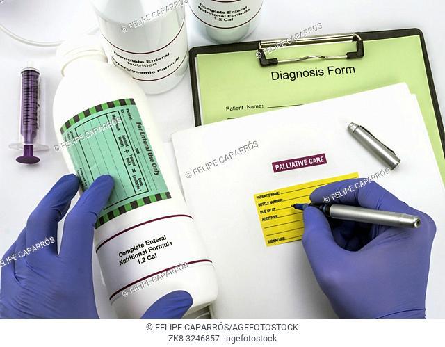 Nurse writing data sick, enteral nutrition palliative care in hospital, conceptual image, composition horizontal