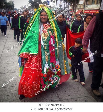 A woman dresses like the Virgin of Guadalupe during the annual pilgrimage to the Our Lady of Guadalupe basilica in Mexico City, Mexico