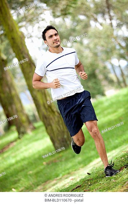 Hispanic man jogging