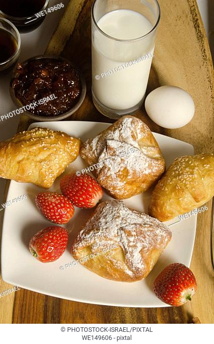 Breakfast with puff pastry and milk
