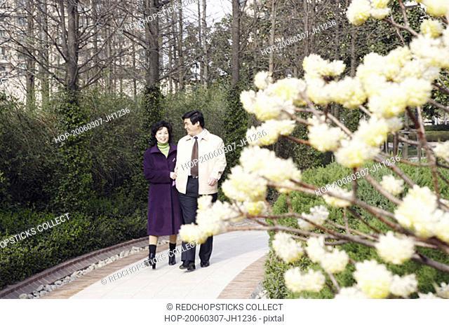 Mature couple walking in a garden