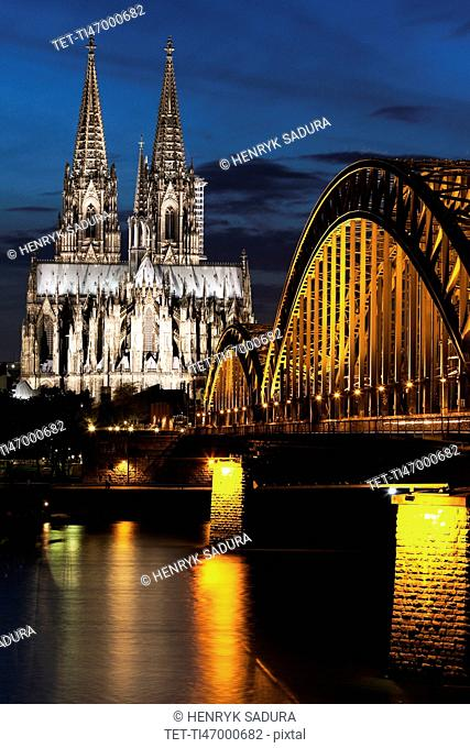 Hohenzollern Bridge and Cologne Cathedral illuminated at night