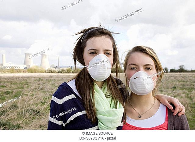 Girls in masks by power station