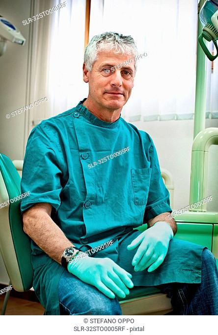 Dentist sitting in office