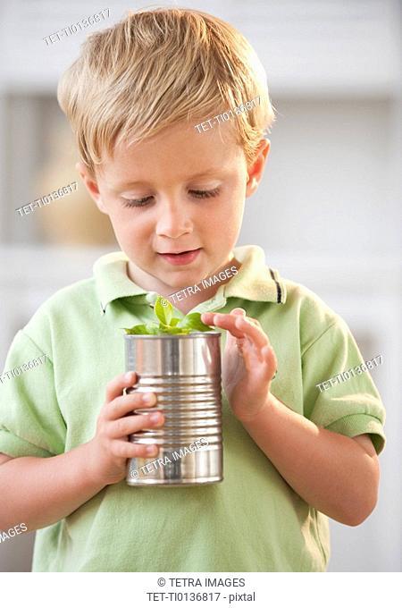 Child examining plant