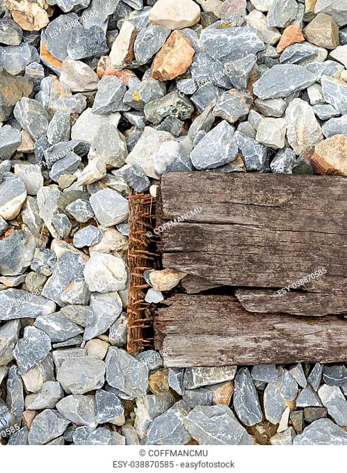 Close up of train track, spike, and wooden railroad tie