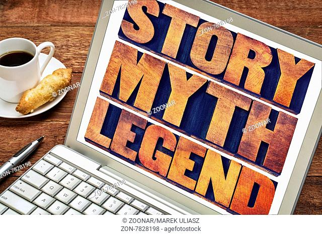 story, myth, legend word abstract - storytelling concept - collage of words in vintage letterpress wood type printing blocks on a laptop screen with a cup of...