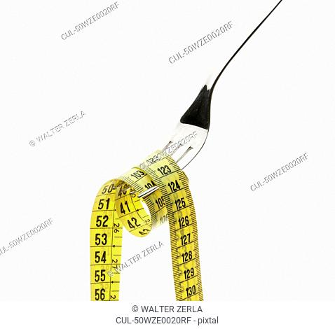 Measuring tape coiled on fork