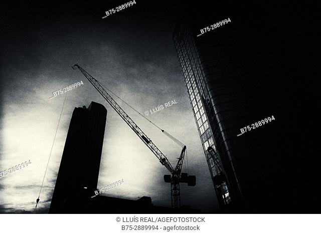 Building at sunset under construction with a crane in the city of London, England, UK, Europe