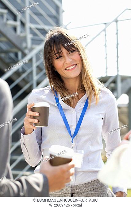 Business people taking a coffee break outdoors