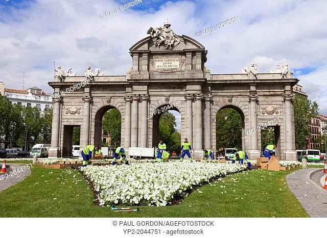 City workers planting flowers at the Puerta de Alcalá - Plaza de la Independencia, Madrid, Community of Madrid, Spain