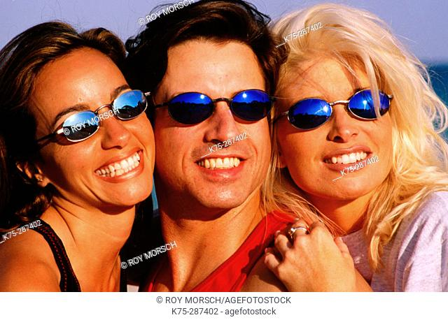 three friends wearing sunglasses