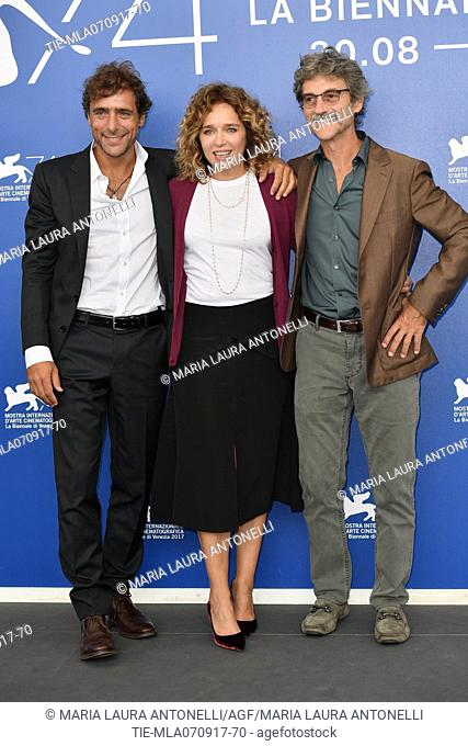 Director Silvio Soldini, Valeria Golino and Adriano Giannini during the photocall of the film Il colore nascosto delle cose. 74th Venice Film Festival