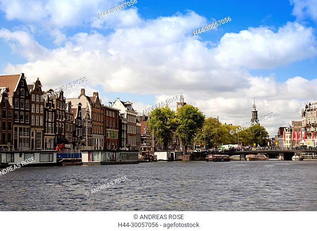 Typical houseboats in front of half-timbered houses in Herrengracht, Amsterdam, Holland, Netherlands